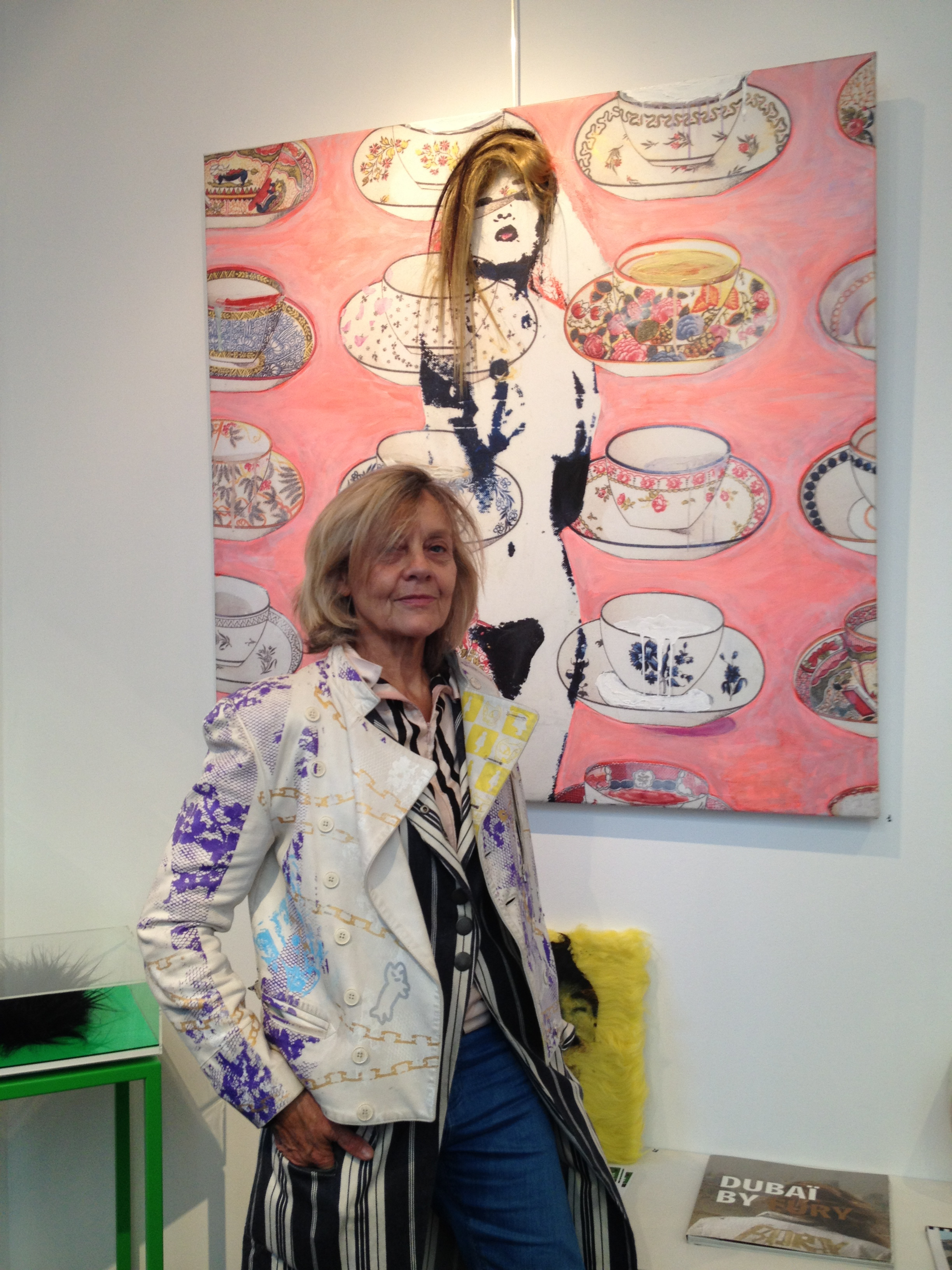 "Dominique Fury with her painting ""Tea Time"" at Galerie Caplain-Matignon Paris Art Gallery Women Artist"